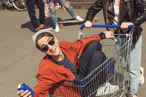 teenagers with shopping cart