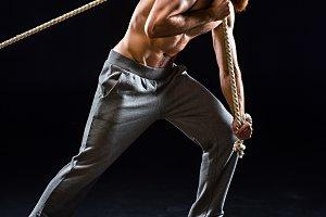 bearded sportsman pulling rope