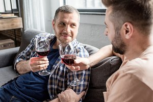 homosexual couple drinking wine
