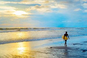 Silhouette of surfer. Bali island