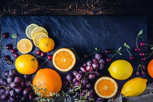 Different fruit on the dark background vertical