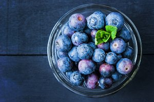 Blueberry with mint in a glass bowl