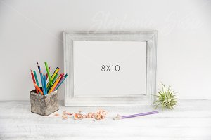 White Frame with Colored Pencils