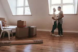 Couple in love moving in new home