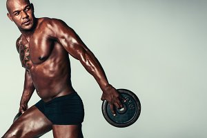 Strong young man exercising