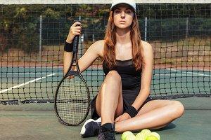 Confident female tennis player