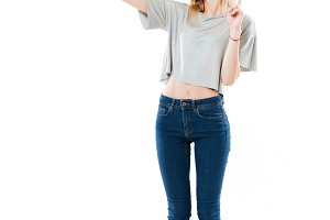 Positive woman making selfie on smartphone