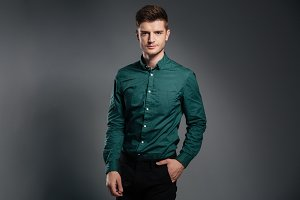 Handsome serious man dressed in shirt posing