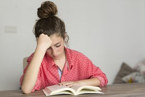 Teen woman reading a book