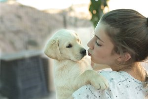 teenage girl with a golden retriever