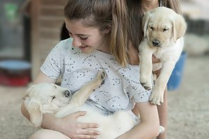 sisters with a golden retriever