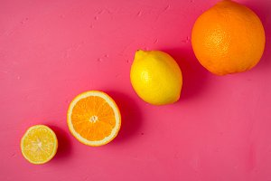 Lemons and oranges on the pink table