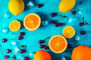 Different fruit on the cyan table