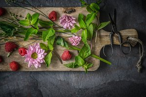 Flowers and mint on the wooden board