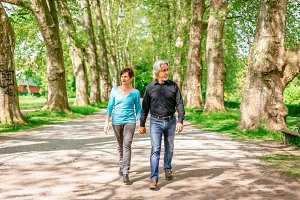 Senior Couple Walking Through A Park, Tuebingen, Germany