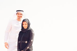 Young Arabian Couple In The Desert