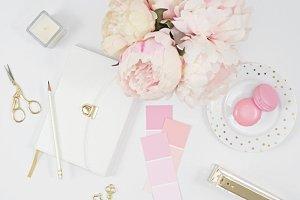 White pink desktop flat lay photo