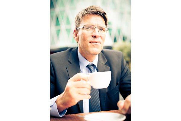 Businessman Having Coffee