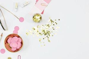 Pink gold desktop flat lay photo