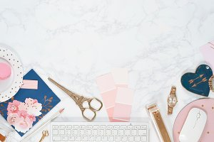 Rose gold navy marble desk flat lay