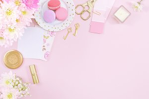 Pink floral macaron flat lay photo