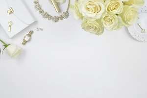 White roses gold desk flat lay