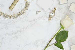 White rose marble gold flat lay