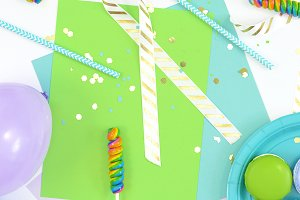 Blue, green party theme flat lay