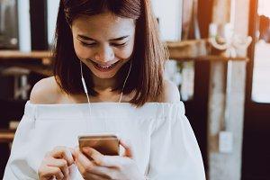 women Listening to music happy