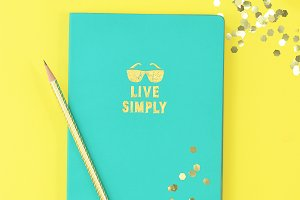 Yellow turquoise desktop flat lay