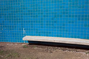 Blue Tiles Wall With Bench