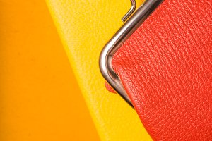 Orange wallet on a yellow notebook