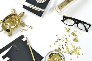Black and gold laptop desk flat lay
