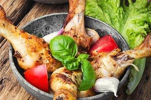 chicken legs with vegetable garnish