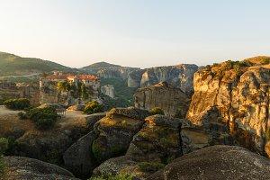 First sun rays on the Holy Monastery of Varlaam on the edge of high rock. Kalambaka, Greece