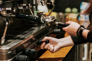 Close-up of barista grinding coffee