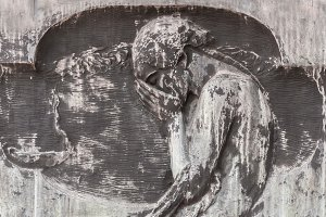Statue of weeping man