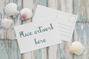White Postcard on blue wood