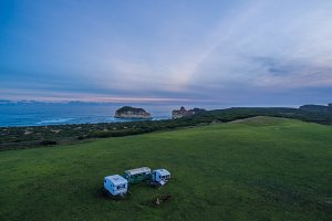 Old caravans and rugged coastline