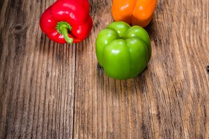 Colorful bell peppers on rustic table