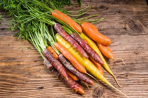 Colorful carrots on a rustic table