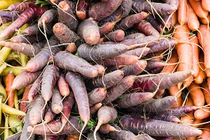 Freshly harvested red carrots at the market