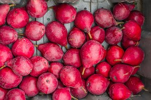 Display of fresh red pears at market