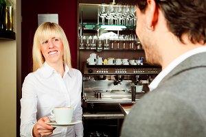 Female Bartende Serving Coffee