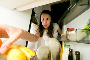Woman Looking Into The Fridge