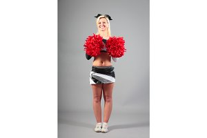 Young Cheerleader On Gray Background