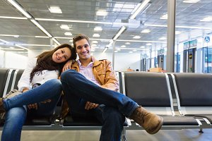Young Couple Waiting To Board Their Flight