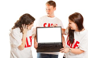 Young People With 'sale' T-shirts And Laptop
