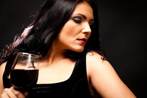 Young Woman Enjoying A Glass Of Wine