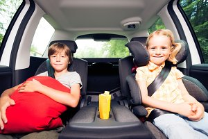 Children Sitting In The Car